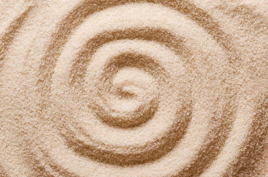 spirale dans le sable, bouger à partir du centre